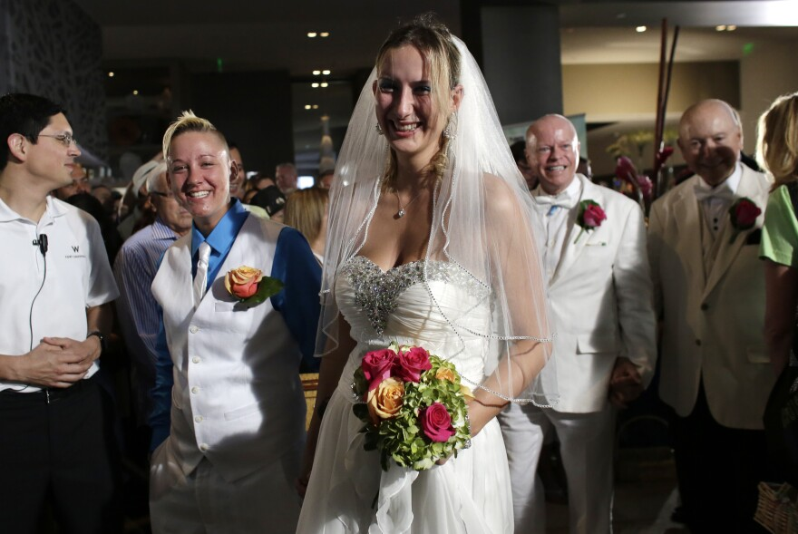 Jessica Dunnam, left, and Charlene Emm, right, arrive with other couples for a group wedding ceremony at a hotel in honor of Florida's ruling in favor of same-sex marriage equality, Thursday, Feb. 5, 2015, in Fort Lauderdale, Fla. In January, Florida became the 36th state where gay marriage is legal.