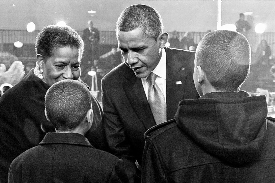 At his second inauguration, President Obama speaks with Nolan Evers, 12, and Alex Evers, 13, about the importance of their grandfather Medgar's work, as their grandmother Myrlie Evers-Williams looks on.