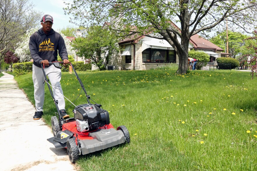 Rodney Smith Jr. mowing the first lawn on his 50-state trip. (Courtesy 50 States 50 Lawns)