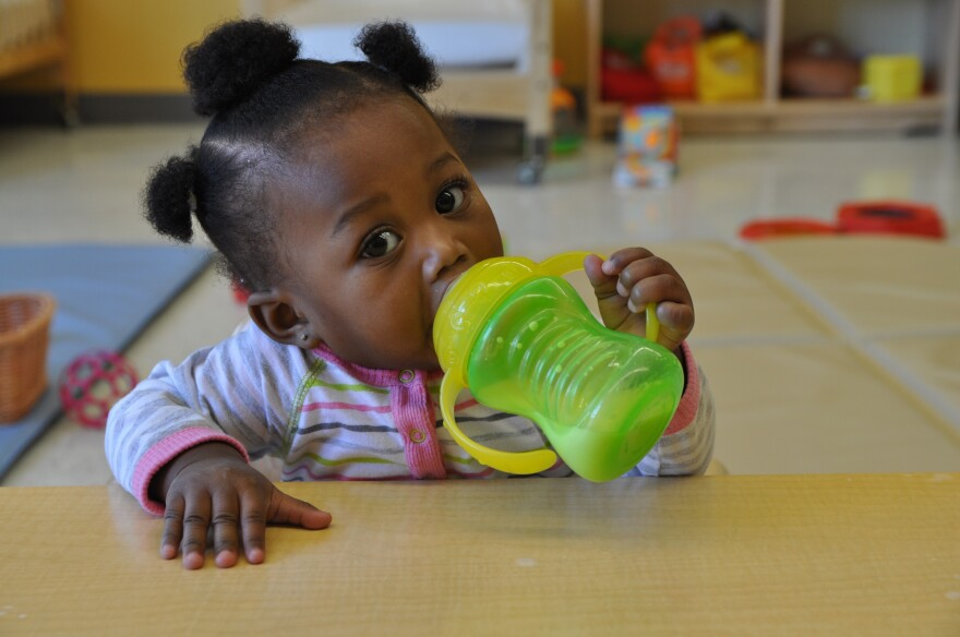 Ma'Layah tries out a sippy cup at the University City Children's Center. 11/21/16
