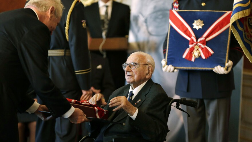 Czech Republic's President Milos Zeman (left) decorates Nicholas Winton with the Czech Republic's highest decoration, The Order of the White Lion, in Prague, on Oct. 28, 2014. Winton, a British citizen who died last year at age 106, saved 669 mostly Jewish children from the Nazis by transporting them out of Prague to Great Britain in 1939.