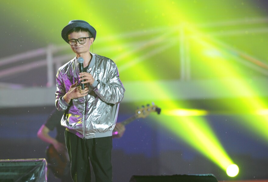 Alibaba founder Jack Ma dresses as a pop star and sings at an event to mark the 10th anniversary of China's most popular online shopping destination Taobao Marketplace, in Hangzhou on May 10, 2013.