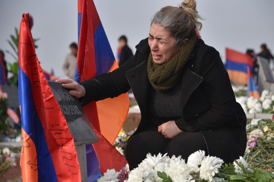Mourners in Yerevan, Armenia, visit the graves of relatives killed during the Nagorno-Karabakh conflict between Azerbaijan and Armenia, Dec. 12. Fierce fighting erupted in the fall, a continuation of a war that started 30 years ago. A Russian-backed cease-fire went into effect in November.