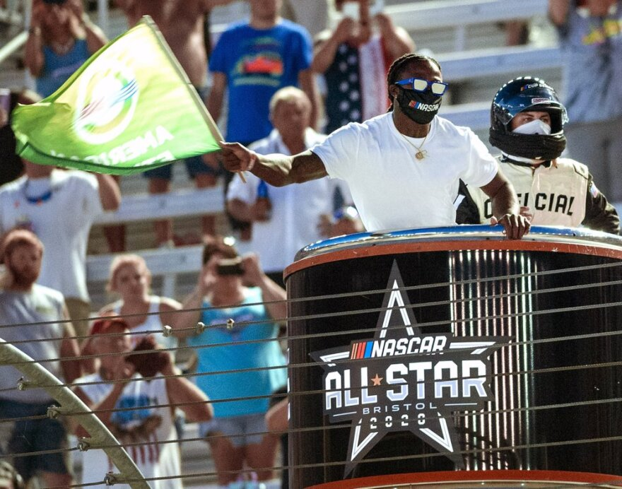 Former University of Tennessee and current New Orleans Saints football player Alvin Kamara waves the green flag to start the NASCAR All-Star auto race at Bristol Motor Speedway on July 15.