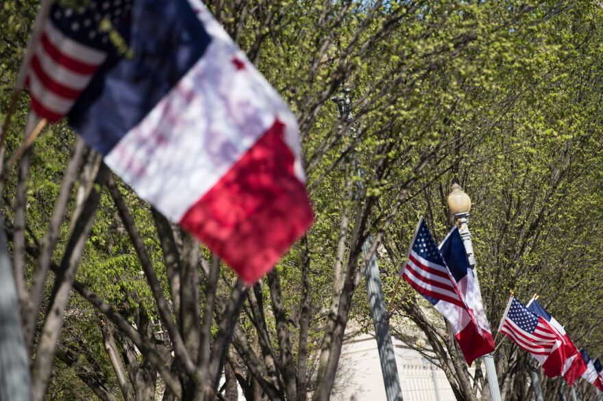 American, French and District of Columbia flags fly near the White House as the capital prepares for an official state visit from French President Emmanuel Macron.