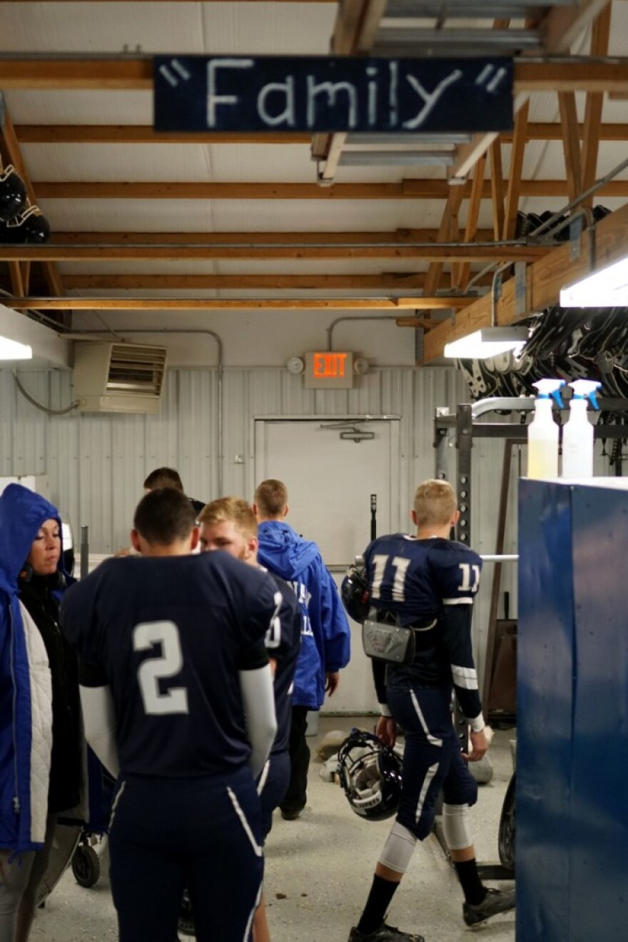 'Family' is the rallying cry of Thomas's football team. It's what players holler when they break out of a huddle, and it's emblazoned on this sign just inside the locker room door.