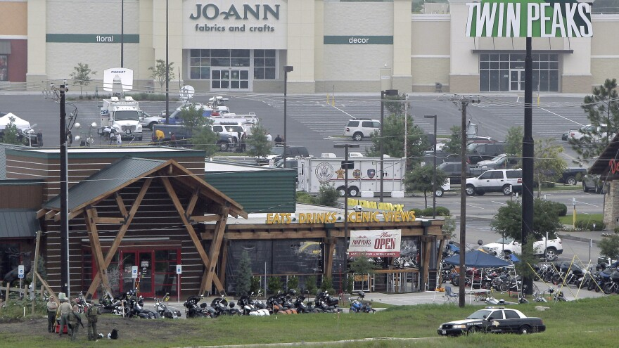 Motorcyles sit in the parking lot of the Twin Peaks restaurant, the scene of a deadly biker gang shootout in Waco, Texas.