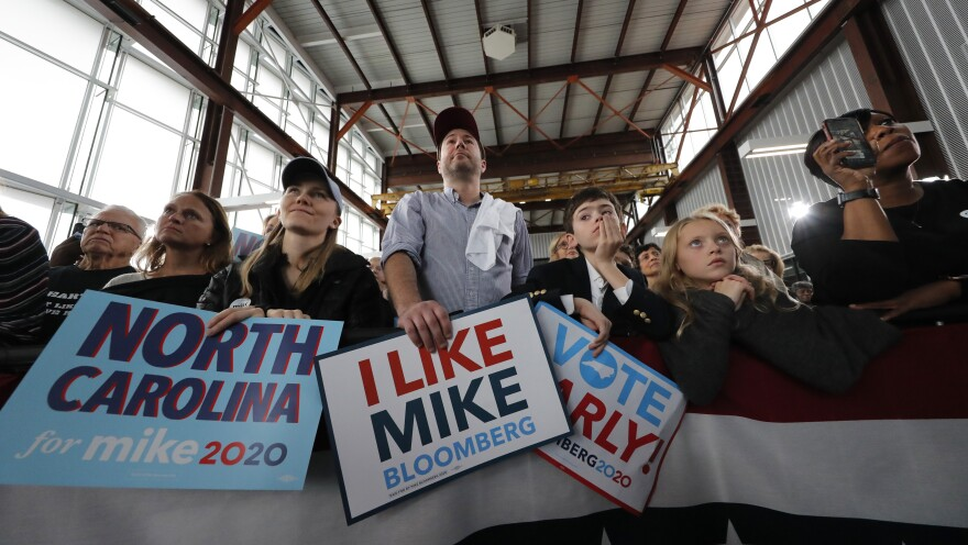 People listen as Mike Bloomberg speaks at a campaign event in Raleigh, N.C., Thursday.