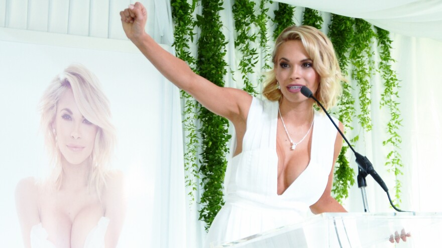"""Dani Mathers, seen here being honored as <em>Playboy's</em> """"2015 Playmate Of The Year,"""" was widely criticized after she posted an image of a naked woman in a gym's shower area."""