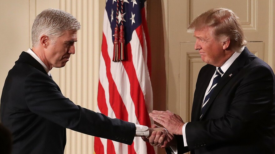 President Trump shakes hands with Judge Neil Gorsuch after nominating him to the U.S. Supreme Court during a ceremony in the East Room of the White House on Tuesday.