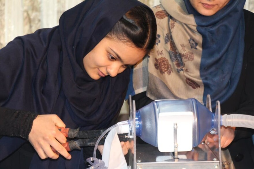 Elham Mansoori, member of Afghan Dreamers, an all-girls robotics team in Afghanistan, works on their prototype of a ventilator.