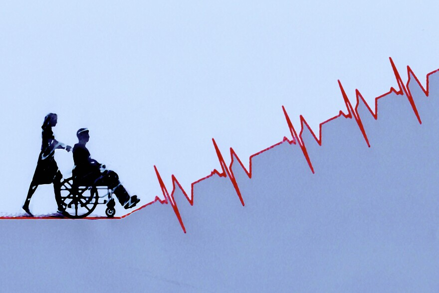 Woman pushing man in wheelchair up ascending pulse trace graph.