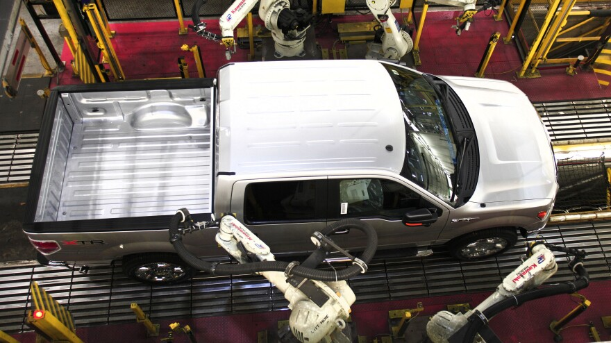 Ford says it sold the most F-series trucks since 2006. Here, a 2014 F-150 goes through quality control on the assembly line at Ford's Dearborn Truck Plant.