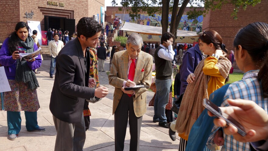 Pakistani actor Zia Mohyedin signs autographs and meets fans before his readings at the Lahore Literary Festival.