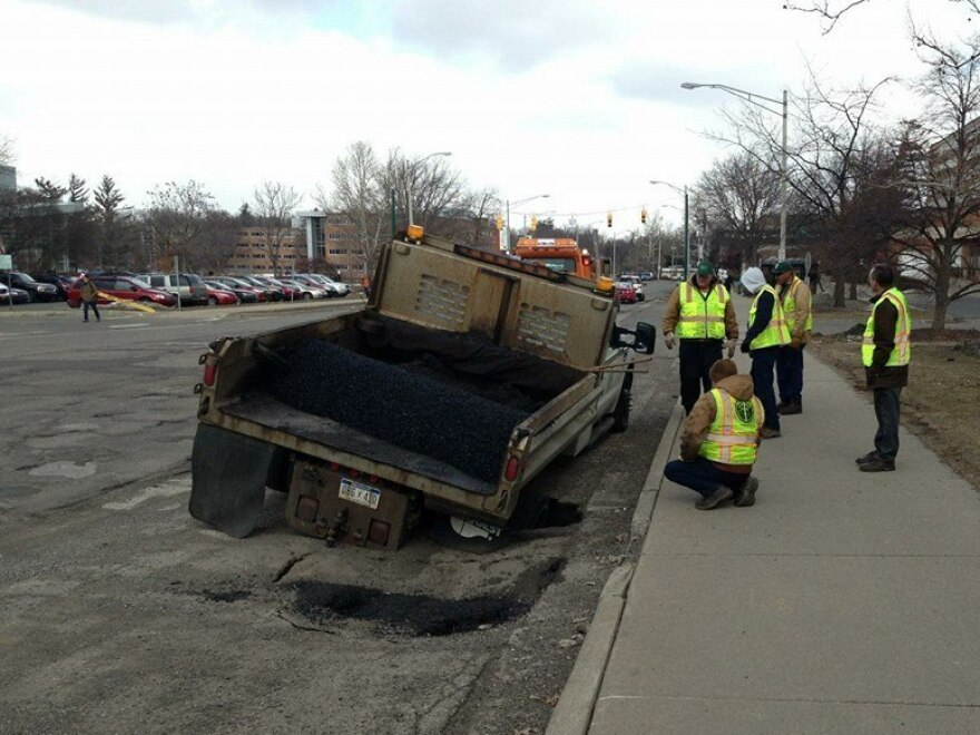 Ka-thunk. This pothole repair crew in East Lansing, Mich., met its match.
