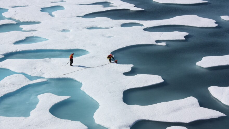 A U.S. Coast Guard crew retrieves a canister dropped by parachute in the Arctic in 2011. Over the past four decades, researchers at the University of California, Santa Barbara, and several other universities have studied shifts in atmospheric circulation above the Arctic.<strong></strong>
