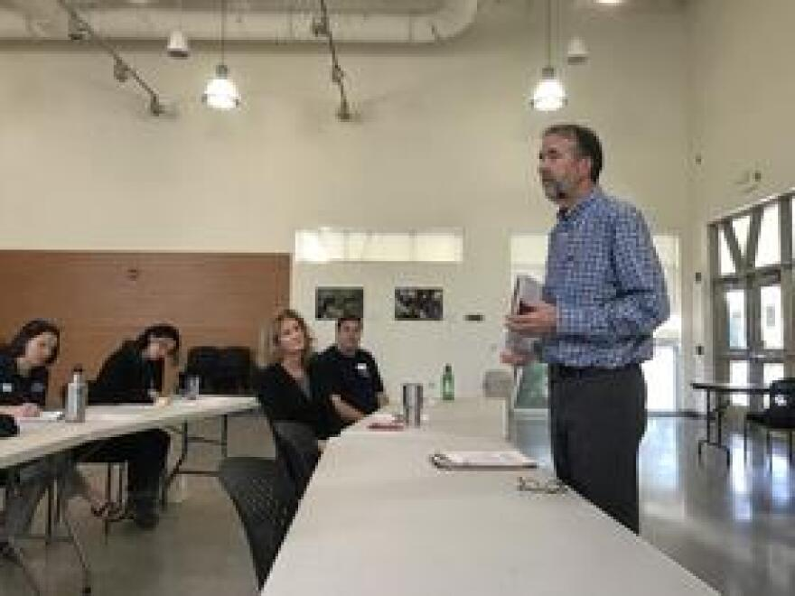 """Workshop leader Bill Bigelow said he wants to help teachers give students """"a sense that they're not spectators to the future."""""""