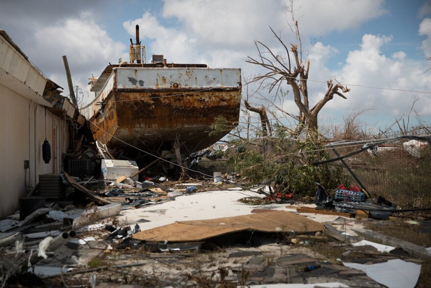 After the Category 5 storm slammed into the Bahamas this week, residents had to deal with wrecked houses and boats that came ashore.