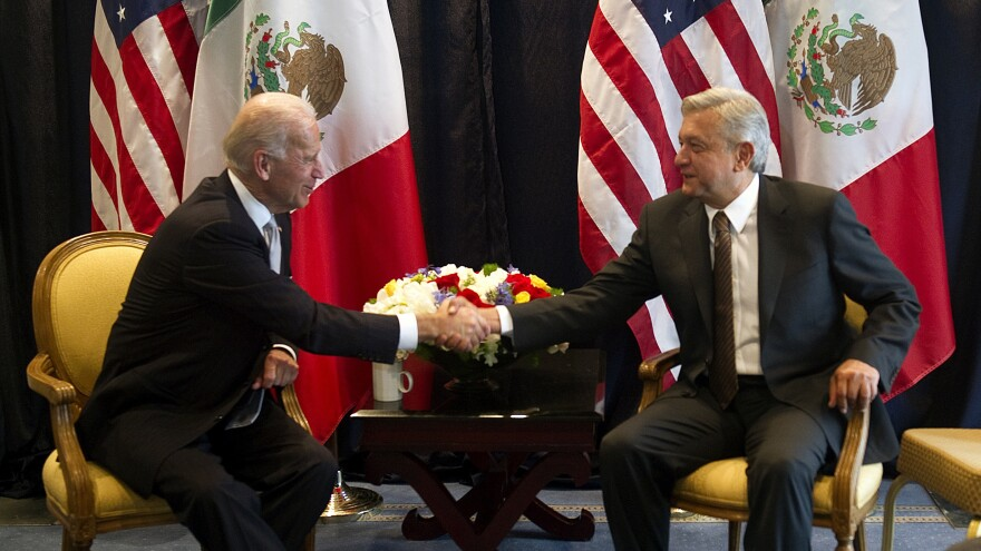 Then-Vice President Joe Biden (left) shakes hands with then-Mexican presidential candidate Andrés Manuel López Obrador, during a meeting on March 5, 2012, in Mexico City.