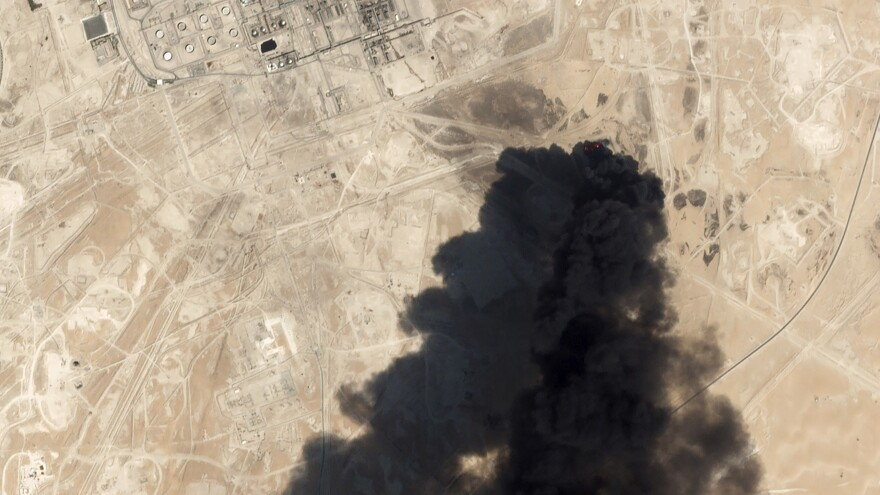 An image from Sept. 14 taken by Planet Labs Inc. shows thick black smoke rising from Saudi Aramco's Abqaiq oil processing facility.