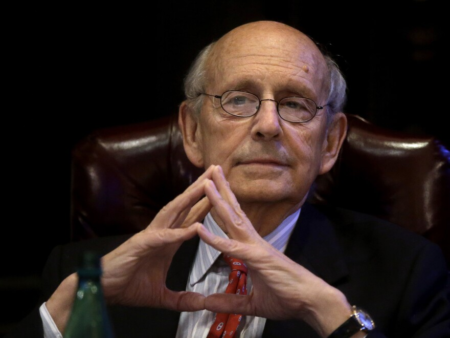Supreme Court Justice Stephen Breyer listens during an event in Boston in February. On Tuesday, a high court argument was interrupted by a ring tone, and Breyer was the culprit.