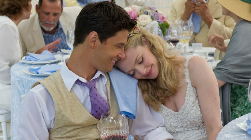 Alejandro (Ben Barnes) and Missy (Amanda Seyfried) take a break from the chaos swirling around their <em>Big Wedding</em> to appreciate the luck that brought so many big-name celebrities out for their big day.