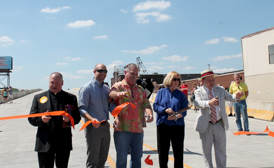 Monsignor Vince Bommarito of St. Ambrose Catholic Church on The Hill, Jeremy Bedenbugh, Lead Pastor of The Journey Church in Tower Grove, Alderman Joseph Vollmer, Mayor Lyda Krewson and Alderman Stephen Conway open Kingshighway Bridge May 13, 2017.