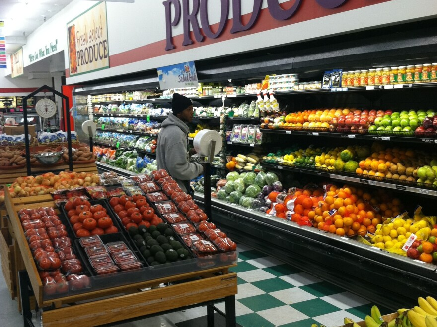 A customer in the produce section at Metro Foodland, one of the Detroit grocery stores participating in a healthy food incentive program for people with SNAP benefits. The store will add a section of specially marked local produce as part of the program.