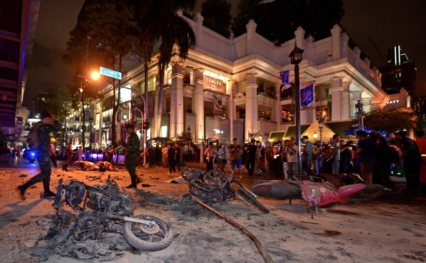 Thai soldiers inspect the scene after a bomb exploded Monday evening near the Erawan Shrine in central Bangkok.