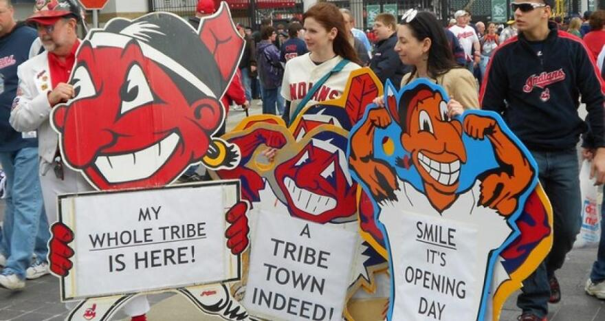 Cleveland Indians fans hold Chief Wahoo signs in 2013.(Brian Bull / ideastream)