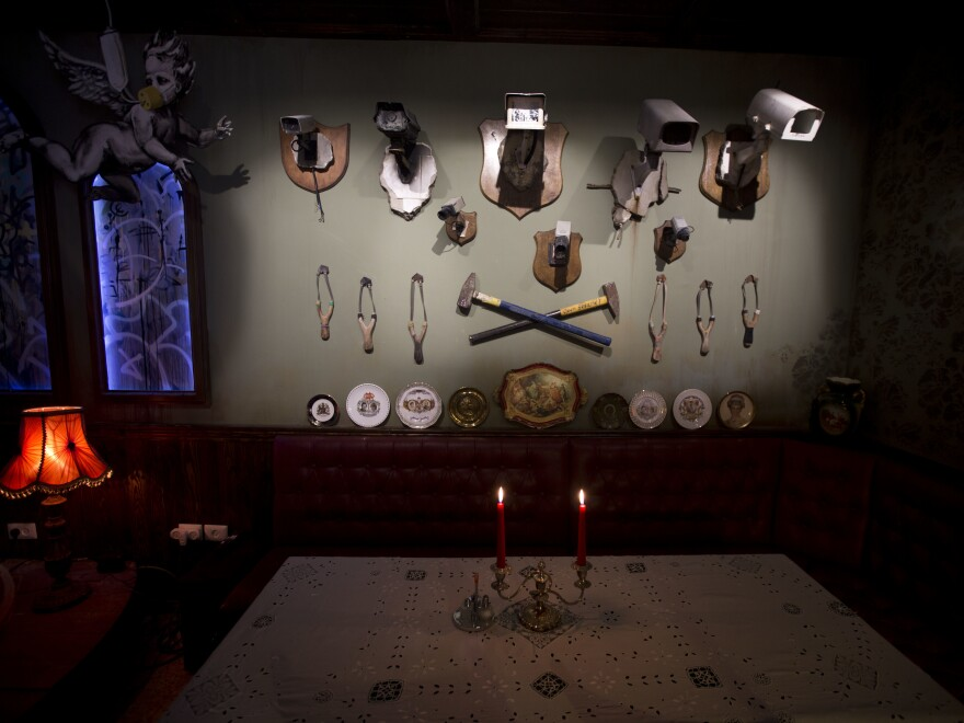 Security cameras and slingshots decorate the bar area of The Walled Off Hotel in the West Bank city of Bethlehem.