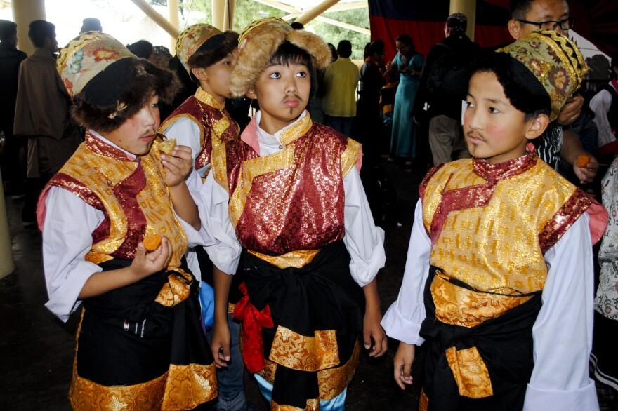 Tibetan children in Dharamsala, India, wait to perform during Monday's celebration.