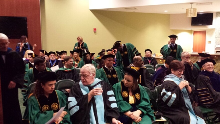 Faculty and the doctoral students they would hood wait for commencement to start.
