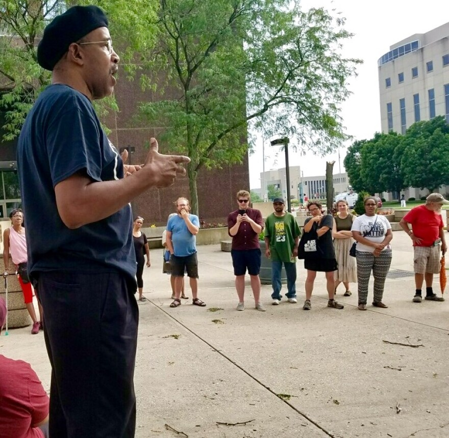 Protesters gathered Saturday in downtown Dayton in advance of the third anniversary of  John Crawford's death in a Beavercreek Walmart.