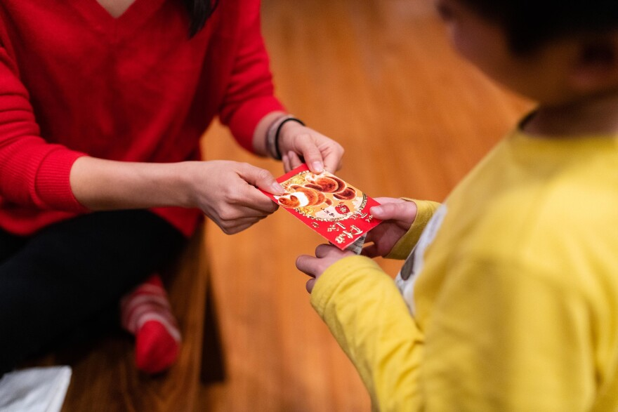 Thao Nguyen gives her nephew, Hayle, a red envelope in celebration of the Lunar New year on Jan. 26, 2020.