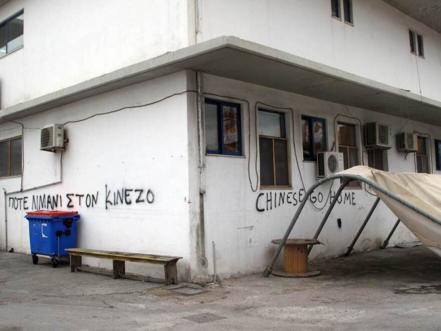 """Graffiti at the smaller Greek pier at Piraeus says """"Chinese go home."""" Greece's dockworkers unions were opposed to the Chinese involvement at Piraeus, although among the general public, the mood was more positive."""
