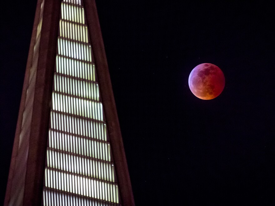 "The ""blood moon"" rises behind the Transamerica pyramid in San Francisco on Sunday."
