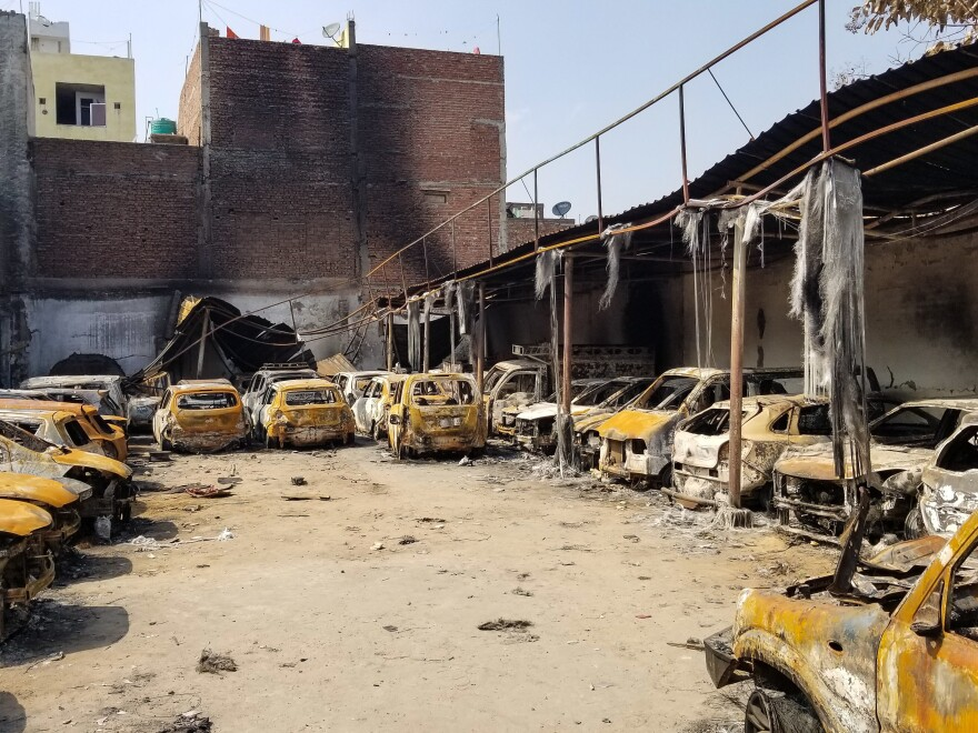 Charred cars are parked in northeastern Delhi after mobs set fire to the area during Hindu-Muslim riots last week.