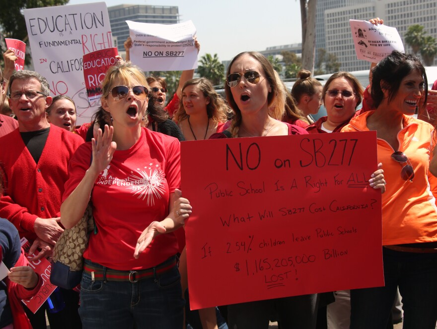 Parents and teachers who oppose efforts to end the personal belief exemption on vaccinations rally in Los Angeles on April 14.