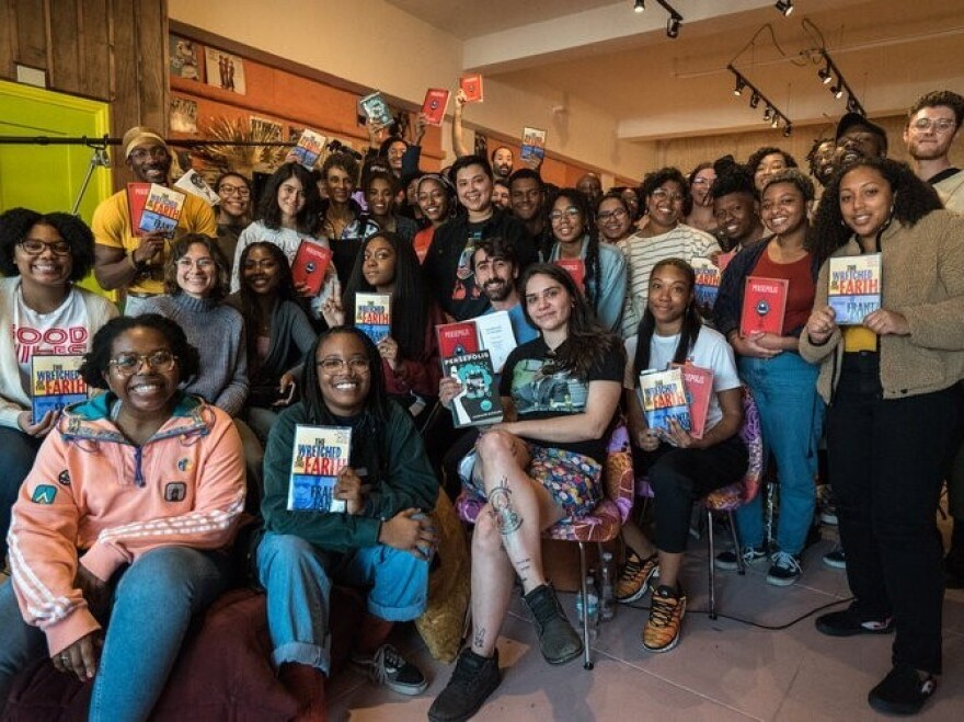 Noname pictured with members of the LA Chapter of her book club.