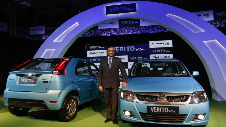 Pawan Goenka of the Indian manufacturing company Mahindra poses with the Verito Vibe compact car in Mumbai in 2013.