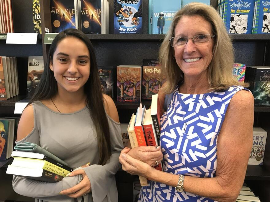 High schooler Emily Deleon shopping for books with her mentor Margie White on a Saturday morning in Naples.