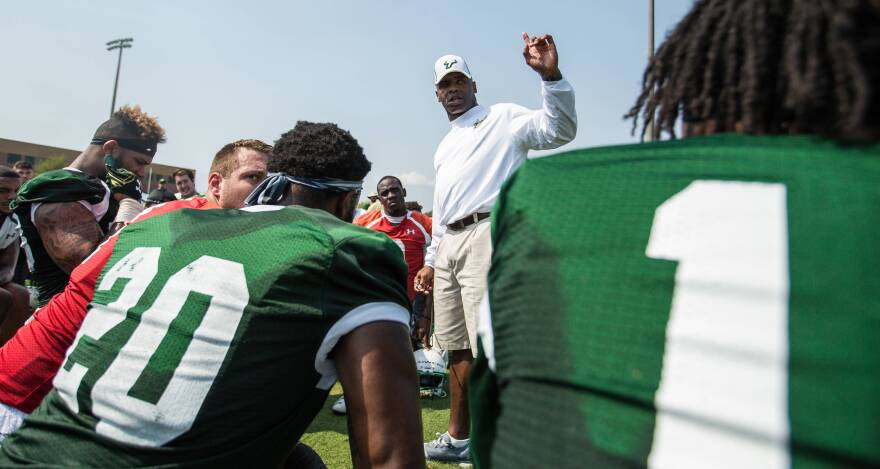 Former USF head football coach Charlie Strong addresses his players in March 2017.