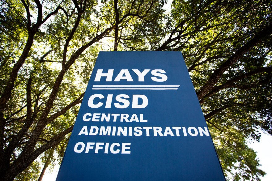 A sign for the Hays CISD central administration office.