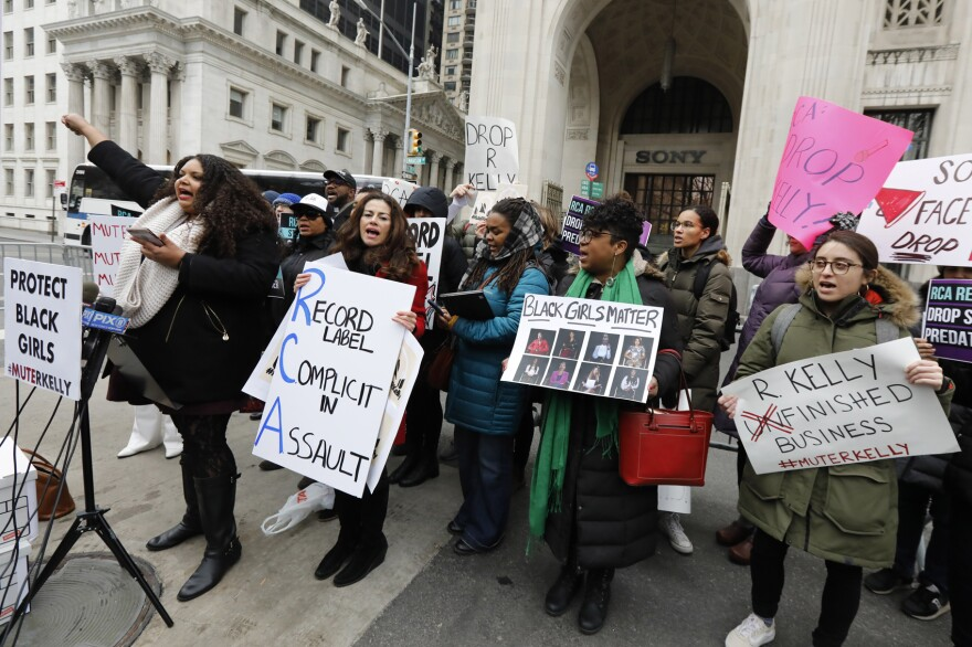 """Sonja Spoo, left, associate campaign director of Ultra Violet, leads chants during an R. Kelly protest outside Sony headquarters, in New York, Wednesday, Jan. 16, 2019.  Kelly has been under fire since the recent airing of a Lifetime documentary """"Surviving R. Kelly ."""" He has denied all allegations of sexual misconduct involving women and underage girls. (Richard Drew/AP)"""