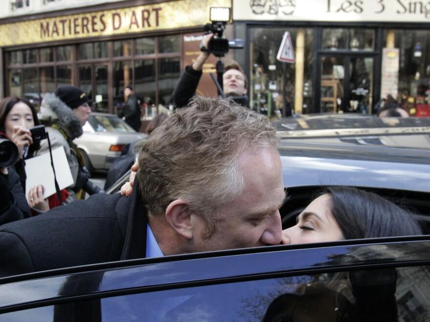 French businessman Francois-Henri Pinault kisses his wife, actress Salma Hayek, in Paris in 2009.