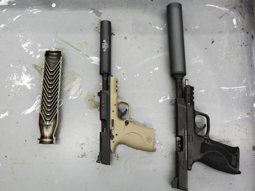 A display of suppressors at an NRA demonstration at the associations headquarters.