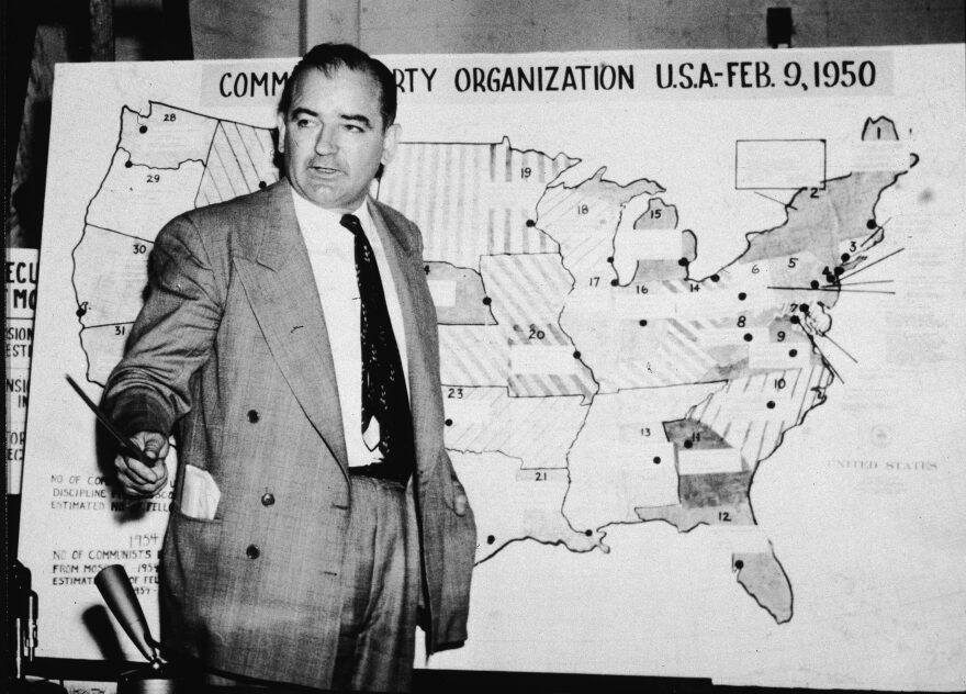 American politician Joseph McCarthy, Republican senator from Wisconsin, testifies against the US Army during the Army-McCarthy hearings, Washington, DC, June 9, 1954. McCarthy stands before a map which charts Communist activity in the United States. (Getty Images)