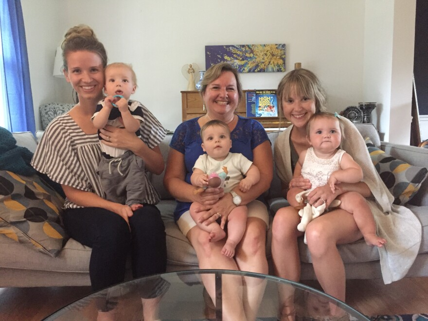 Jenny Holmstrom (left) with son Kyson, Lisa Anderson (center) with grandson Josiah, and Katie Matthews with her daughter Eden.