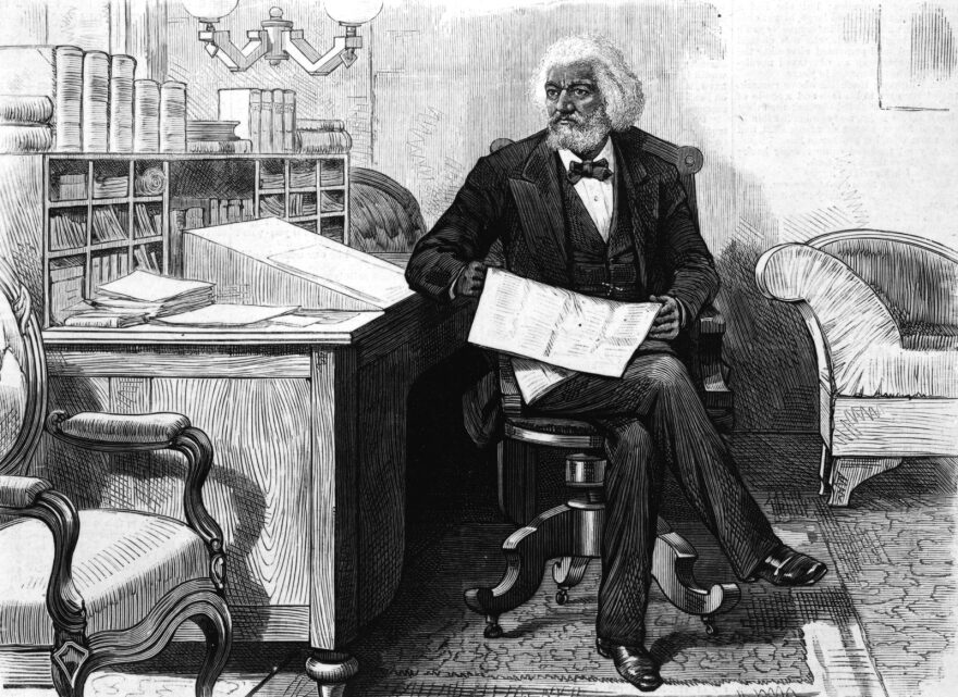 American orator, editor, author, abolitionist and former slave Frederick Douglass (1818 - 1895) edits a journal at his desk, late 1870s.